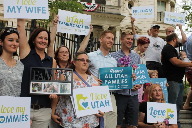 A group of people who support marriage equality gather outside the Utah Governor's Mansion.
