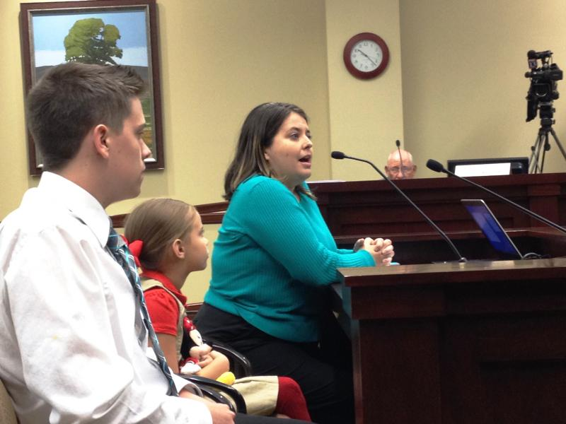 Charlotte Lawrence testifies along with her children to the Utah Health Reform Task Force.