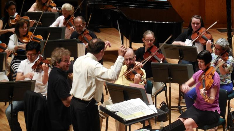 Utah Governor Gary Herbert rehearses with the Utah Symphony and its music director, Thierry Fischer