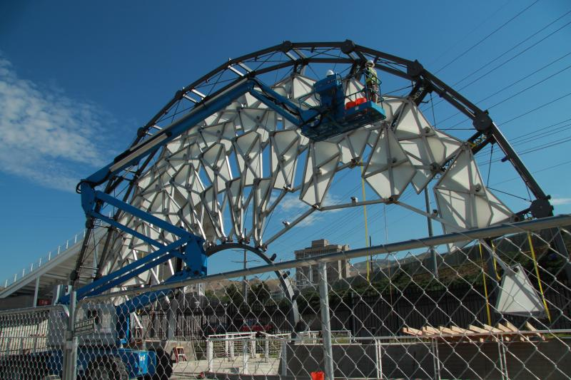 Crews begin disassembling the Hoberman Arch