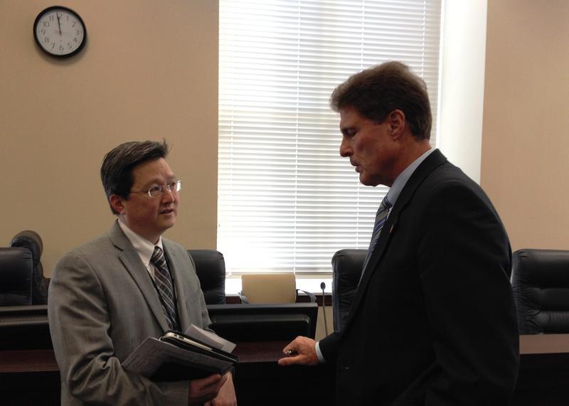 Republican Representatives Dean Sanpei and Jim Dunnigan confer after a Utah Health Reform Task Force meeting. (October 23, 2014)