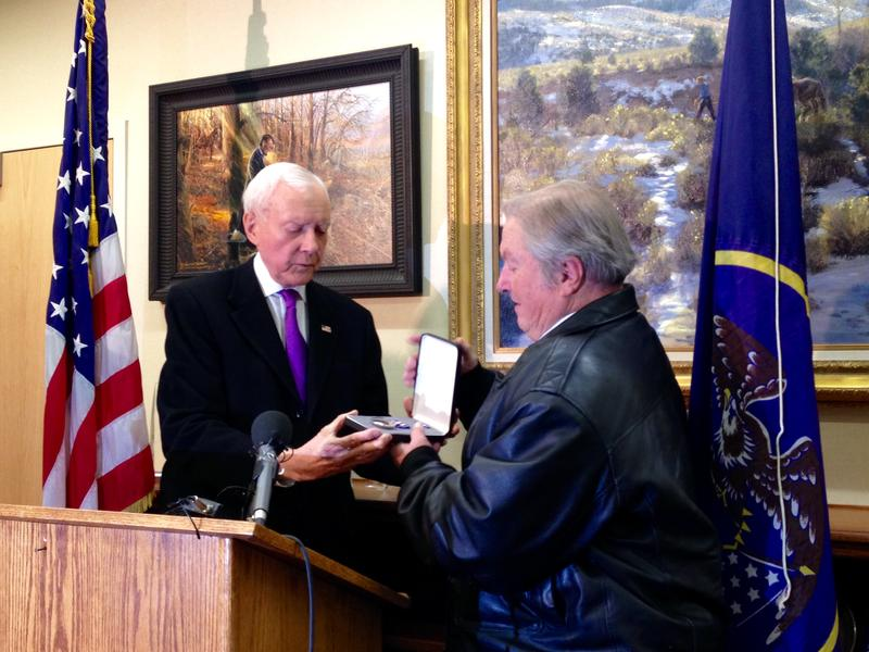 Utah Senator Orrin Hatch presents the military's Silver Star to Jeff Roberts, the son of Corporal Jeremiah Roberts.