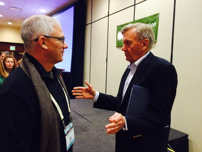 Former U.S. Interior Secretary Bruce Babbitt speaks Thursday with Frank Hugelmeyer, who recently stepped down as the Outdoor Industry Association's CEO.