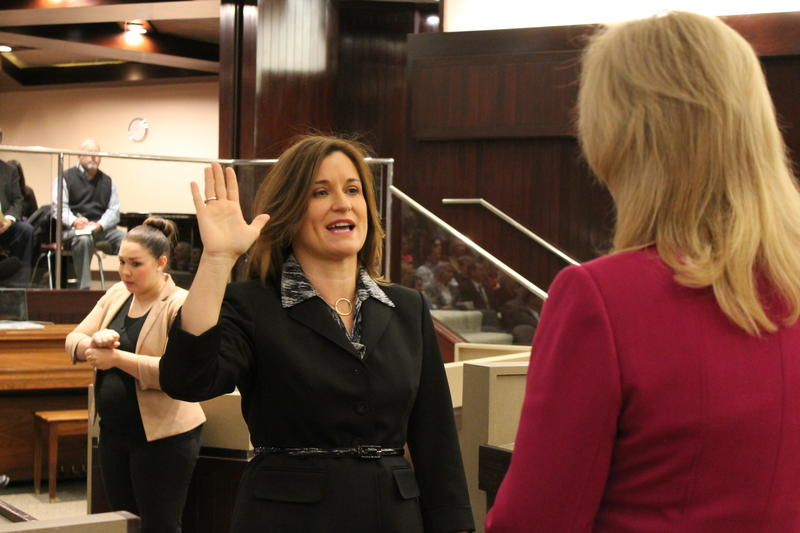 Salt Lake County Clerk Sherrie Swensen swears in newly-elected Councilwoman Jenny Wilson.