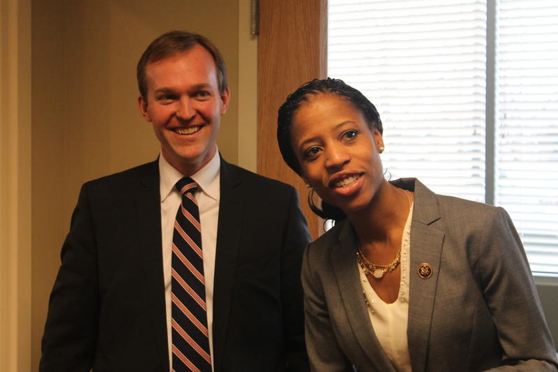 Representative Mia Love and Salt Lake County Mayor Ben McAdams chat at the Congressowoman's new district office in West Jordan.