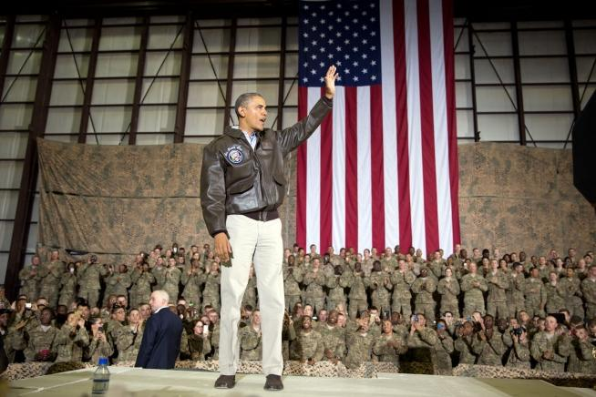 President Barack Obama waves at the conclusion of his remarks to U.S. troops at Bagram Airfield in Bagram, Afghanistan, Sunday, May 25, 2014.