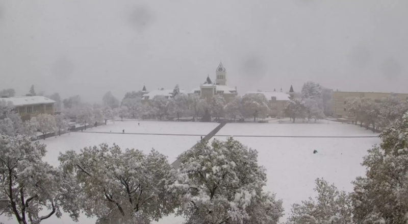 Old Main on the Utah State University campus saw around 4 inches of snow by midday Wednesday.
