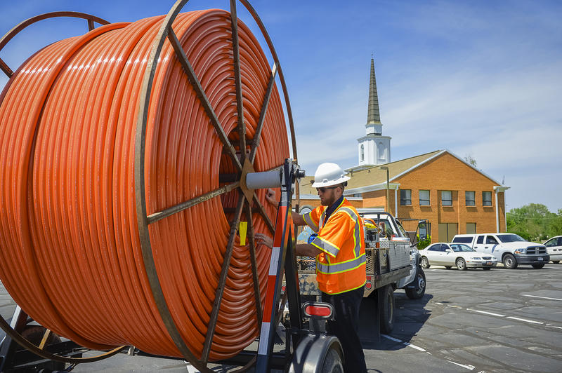 The orange conduit line will protect the glass fiber cables underground.