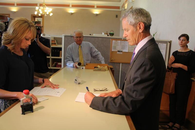 Salt Lake City Mayor Ralph Becker signing paperwork to file for re-election.