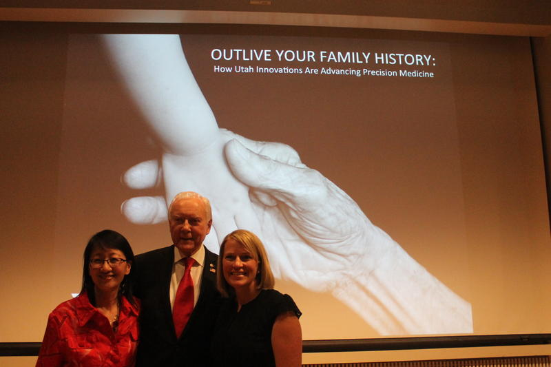 University of Utah Health Care CEO Vivian Lee, Senator Orrin Hatch (R-UT), and patient advocate Emily Scalley pose at the Eccles Institute of Human Genetics.