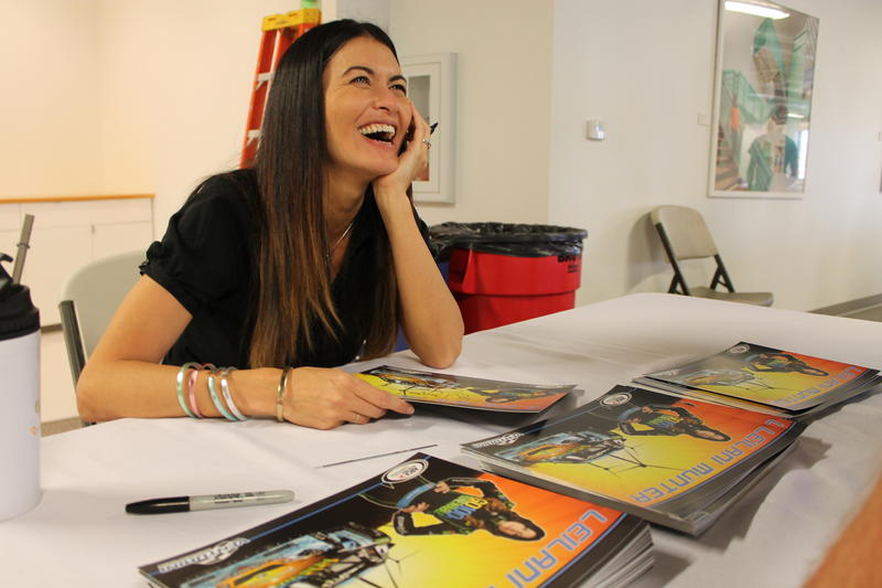 Leilani Munter gives autographs to employees at 3form in West Valley City, UT. (Sept. 21, 2015)