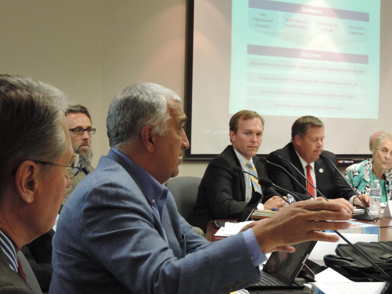 Salt Lake County District Attorney Sim Gill (left) speaks before the Criminal Justice Advisory Council on Sept. 9th, 2015.