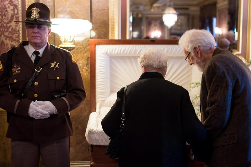 Vistors pay tribute to Governor Olene Walker at a viewing inside the Gold Room of the Utah State Capitol