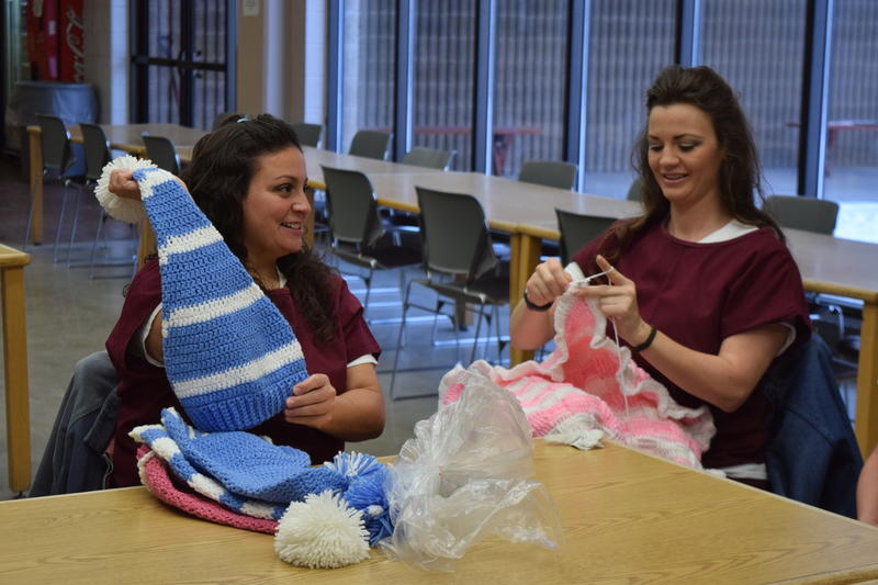 Inmates Daniella Ruiz and Haylee Cheek prepare gifts for their children before a holiday party.