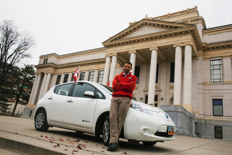 Jared Campbell with his Nissan Leaf on the plaza at the Park Building