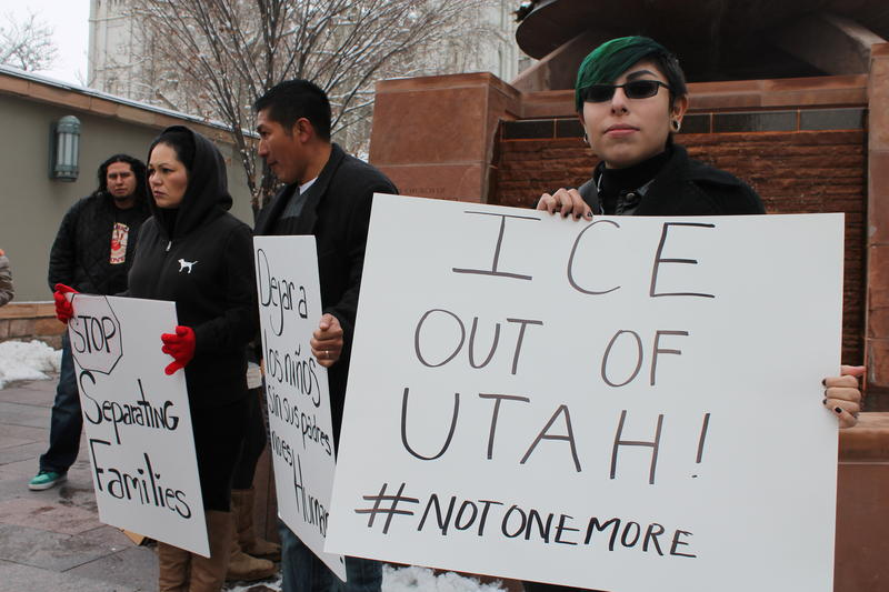 Adrian Romero and other demonstrators hold signs that they made before a demonstration at Temple Square.