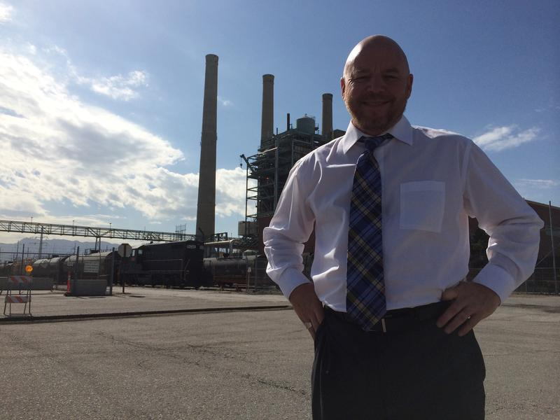 Rocky Mountain Power spokesman Paul Murphy stands outside the Gadsby plant in Salt Lake City. The 2015 energy mix means a rate reduction for customers over the next year.