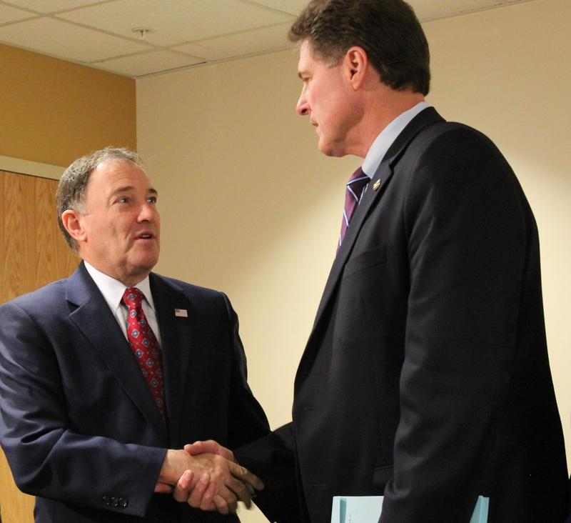 Governor Gary Herbert shakes hands with House Majority Leader Jim Dunnigan, who sponsored the bill that expands medicaid to 16,000 more Utahns.