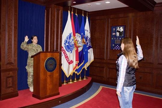 Capt. Christina James of the Salt Lake Military Entrance Processing Station swearing into the United States Army, Tara McCaig, the first woman to enlist into the Infantry in Utah.