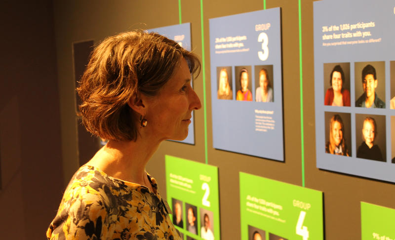 Lisa Thompson, NHMU's director of exhibits explains the Trait Tree, one the interative displays.