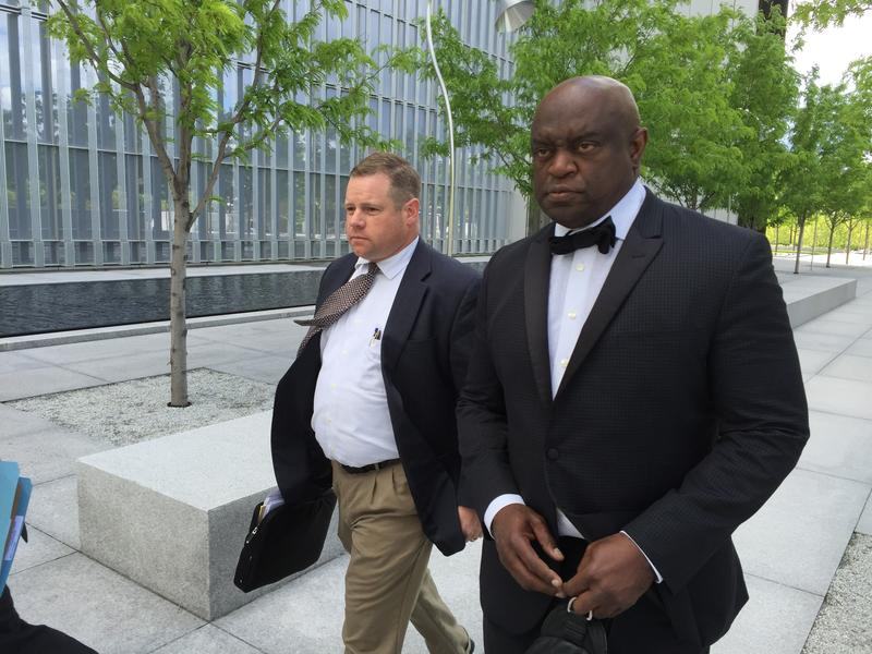 Dr. Simmon Lee Wilcox leaves the federal court house in Salt Lake City with his lawyer Brian Frees. (May 9th, 2016)