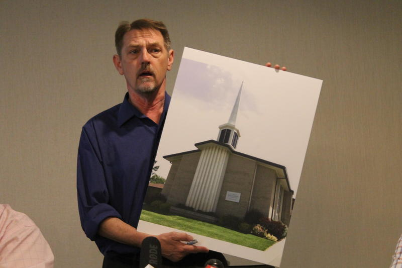 "David Clohessy, Director of SNAP, holds a photo of the LDS Church attended by plaintiff ""L.K."" while particpating in the Lamanite Placement Program."