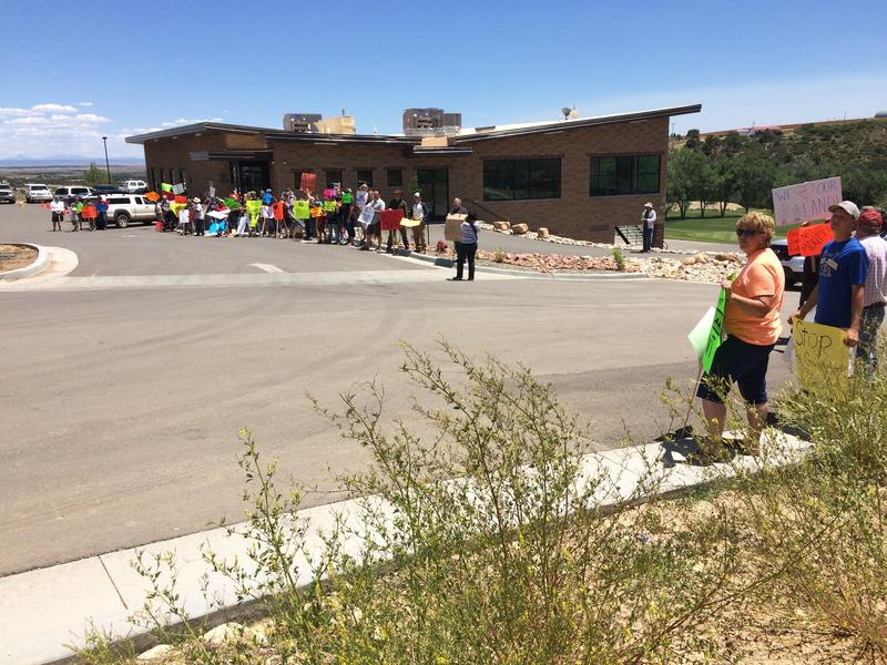 Protestors lined up to greet U.S. Interior Secretary Sally Jewell for her meeting Thursday with local Native Americans and San Juan County Commissioners, who voiced support for the Public Lands Initiative and against a new national monument.