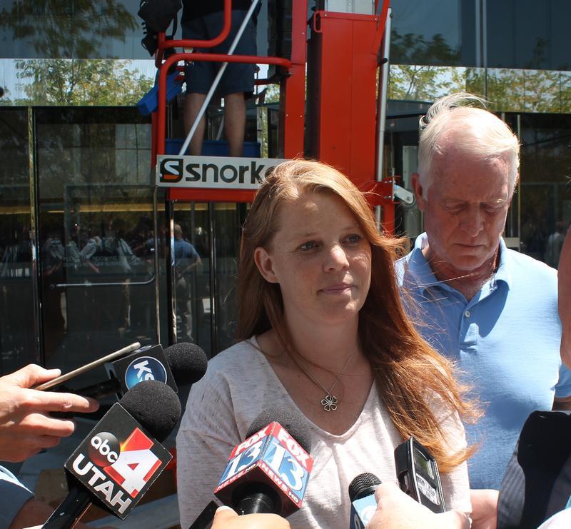 Jeremy Johnson's wife Sharla addresses the media outside federal court in Salt Lake City.