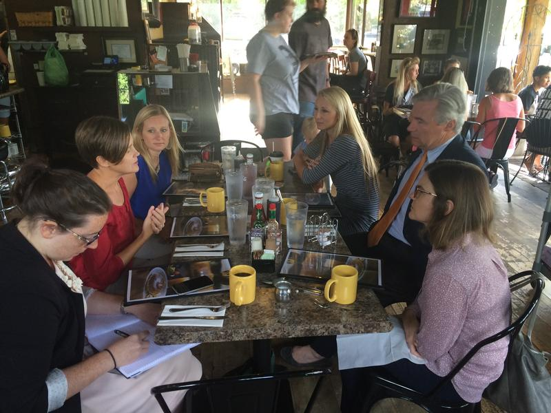 Brooke Froelich, center, takes part in a discussion about climate change and air pollution with Sen. Sheldon Whitehouse, R-Rhode Island, and local environmentalists.