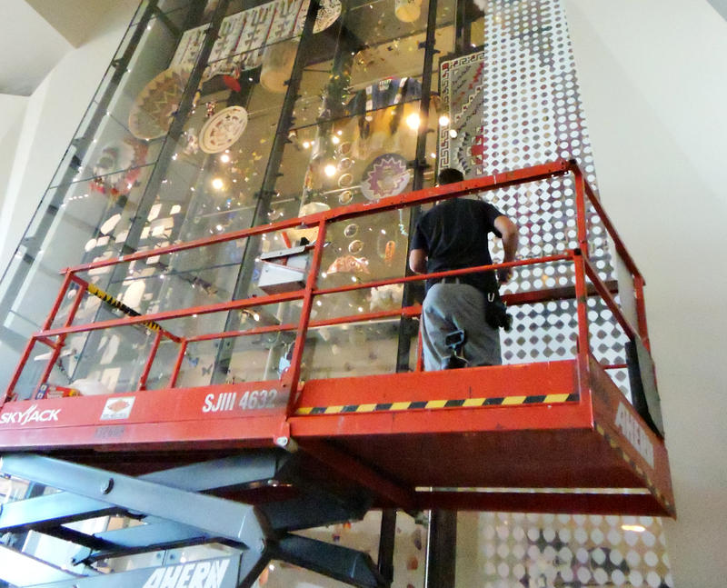 Mylar screen being applied to 36' display in the Canyon at Natual History Museum of Utah
