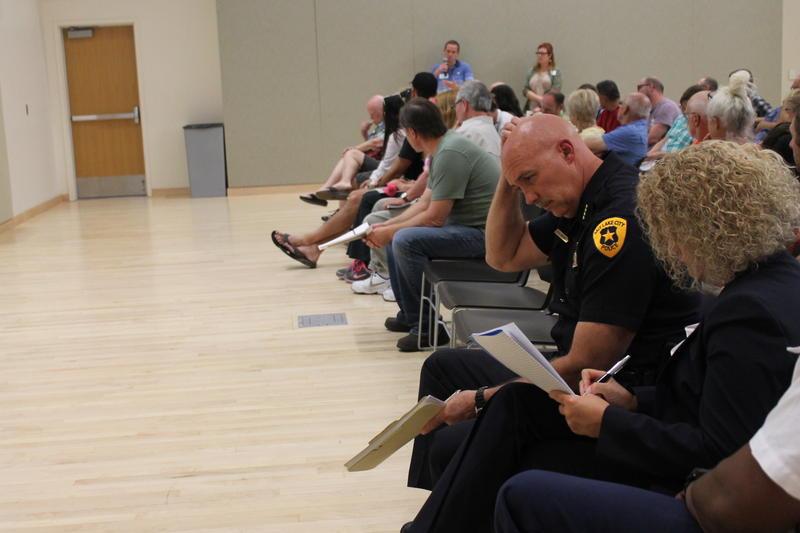 Salt Lake City Police Chief Mike Brown sits with Salt Lake City Mayor Jackie Biskupski Monday at a town hall meeting on crime.