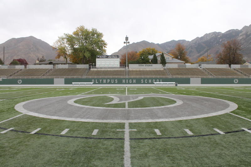 "Olympus High School's ""Titan Stadium"" will now be known as the ""Mark H. Manning Stadium"" and features the ""Hook O"" logo Manning designed while Principal of the school."