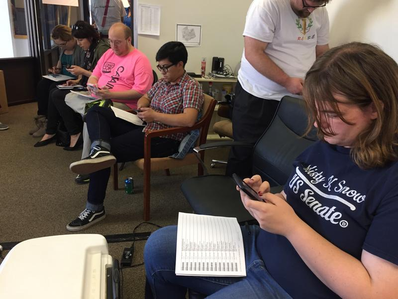Misty K. Snow, right, texts millennial registered voters during a phone bank event on Oct. 22. The 31-year-old progressive is trying to unseat incumbent Republican Sen. Mike Lee.