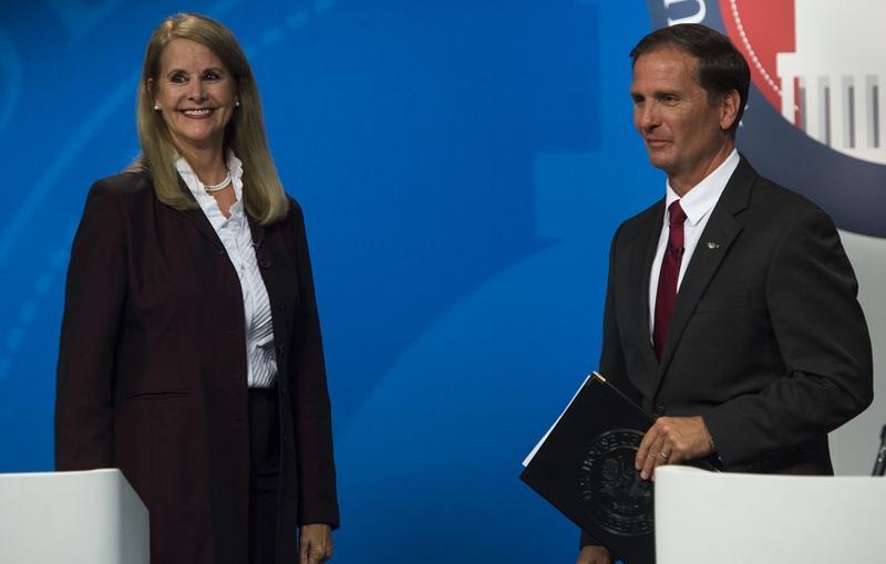 Charlene Albarran and Chris Stewart debate at the University of Utah earlier this month.