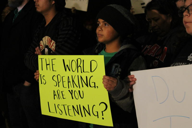 Nine-year-old Tristin Robles joins his grandmother at Wednesday's rally at city hall.