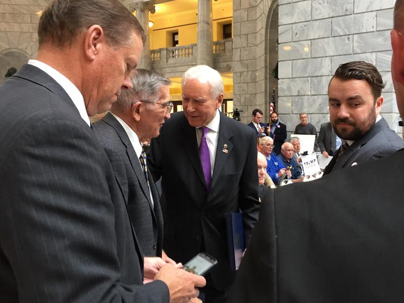 Sen. Orrin Hatch greets people at a campaign rally for Donald Trump in the state capitol.