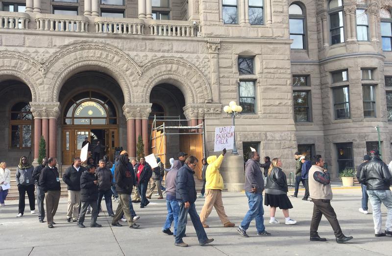 Cab drivers protest ride-sharing regulations at Salt Lake City Hall, Nov. 30, 2016.