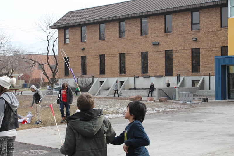 Students play outside Salt Lake Arts Academy, which is situated nearby a new planned homeless shelter.
