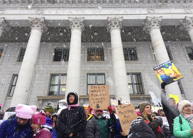 Protesters at the Salt Lake City Women's March gathered on the steps of the Utah Capitol building on the first day of the state's legislative session.