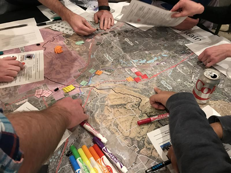 Participants map out ideas for the Point of the Mountain region at a public workshop in Draper on Feb. 15.