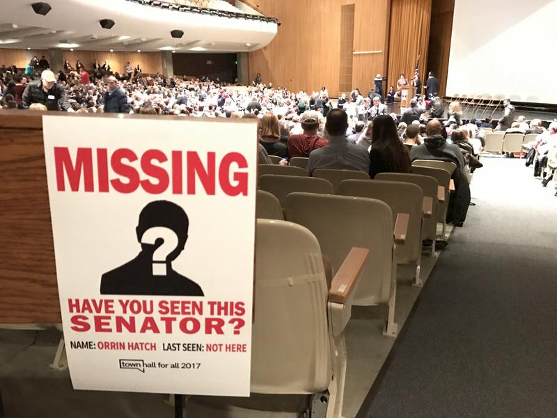 """Missing"" posters were hung around the Town Hall For All at Cottonwood High on Friday night after members of Utah's Congressional delegation declined to attend the public forum."