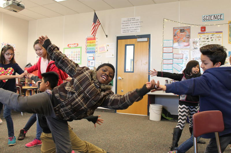 Fourth graders at Escalante Elementary School in Salt Lake City's Rose Park neighborhood stretch their bodies out like cirrus clouds during a theater workshop.