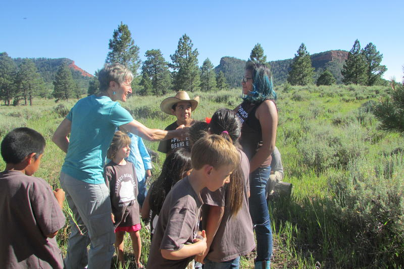 Former Interior Secretary Sally Jewell met with children last summer at what is now part of the Bears Ears National Monument. Utah politicians say they want the monument abolished and that's made outdoor companies call to relocate their Utah trade show.