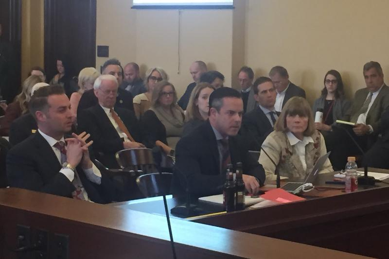 Rep. Brad Wilson, R-Kaysville, is flanked by Melva Sine (right) of the Utah Restaurant Association and Lincoln Shurtz (left) of the Salt Lake Area Restaurant Association, as he presents HB 442, March 1, 2017.