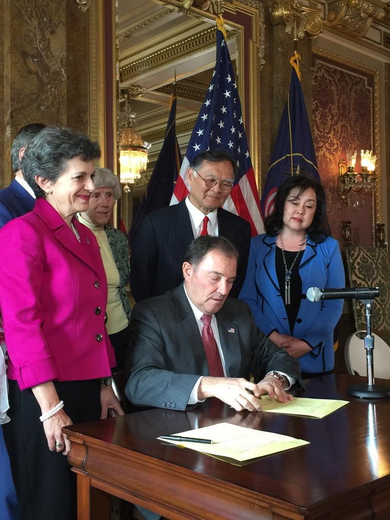 Governor Gary Herbert joins Senator Brian Shiozawa, Representative Patrice Arent and Senator Jani Iwomoto to sign Senate Concurrent Resolution 6 at the Utah Capitol on Monday.
