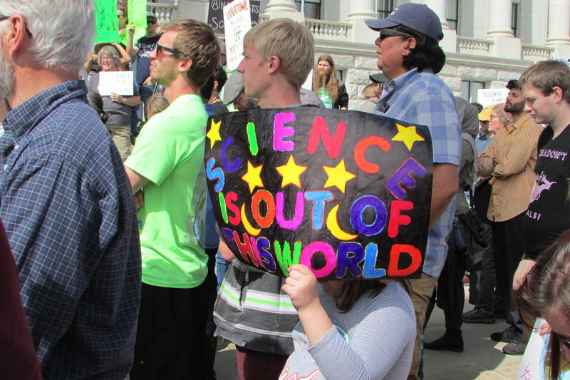Science lovers carried a wide range of posters at Saturday's march. Some had politicial overtones. Some did not.