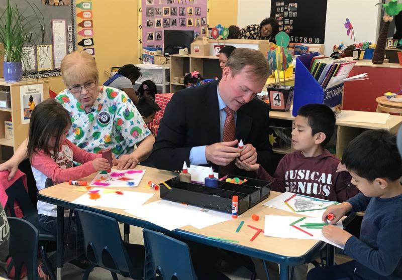 Janice Jenkins and Salt Lake County Mayor Ben McAdams help kids at a Head Start center in South Salt Lake make crafts.