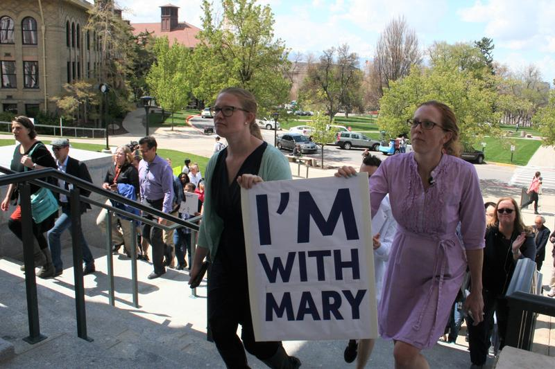 Members of the University of Utah faculty marched to University President Pershing's office to deliver a letter urging Mary Beckerle be reinstated as Director of the Huntsman Cancer Institute.