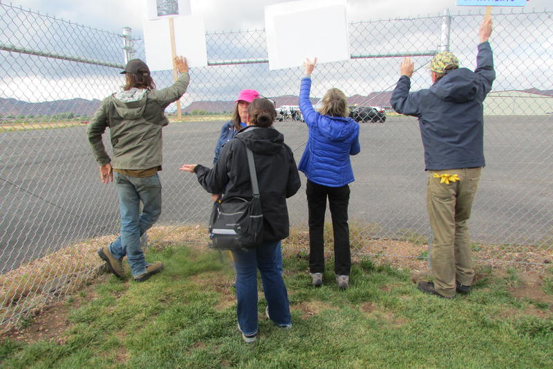 The Boulder Escalante Chamber of Commerce organized a rally and protest when Interior Secretary Ryan Zinke declined to meet with them. Here, they hold their signs as Zinke gets ready to fly home from the Kanab Airport two weeks ago.