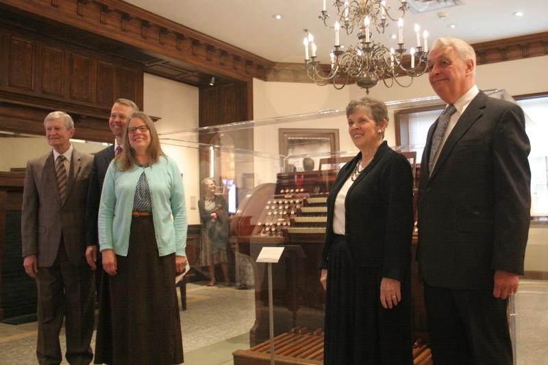 Former Tabernacle organist John Longhurst and current organists Andrew Unsworth, Linda Margetts, Bonnie Goodliffe, and Clay Christiansen pose in front of a 1901 Tabernacle organ.
